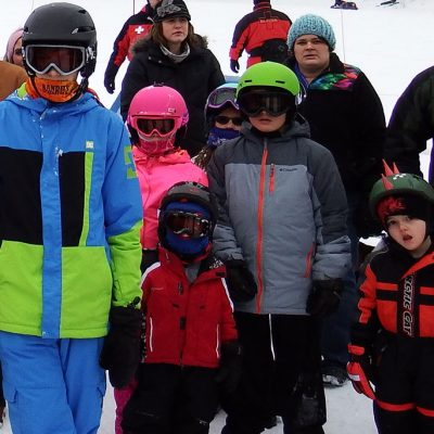 Kids dressed in ski clothes waiting to begin a race