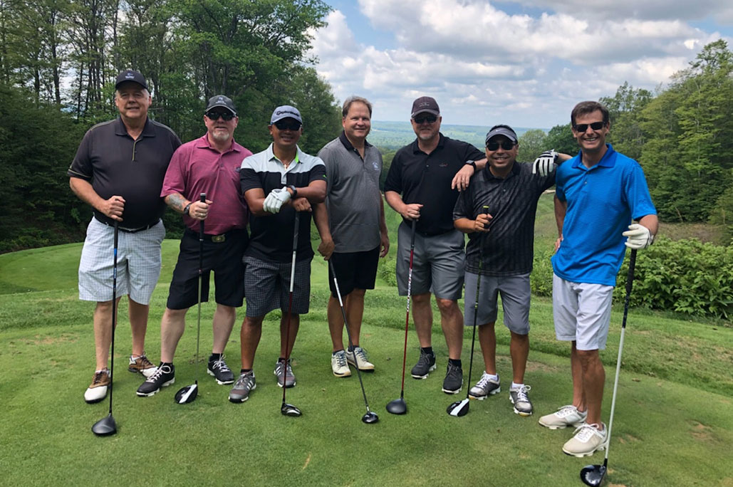 group of male golfers holding clubs