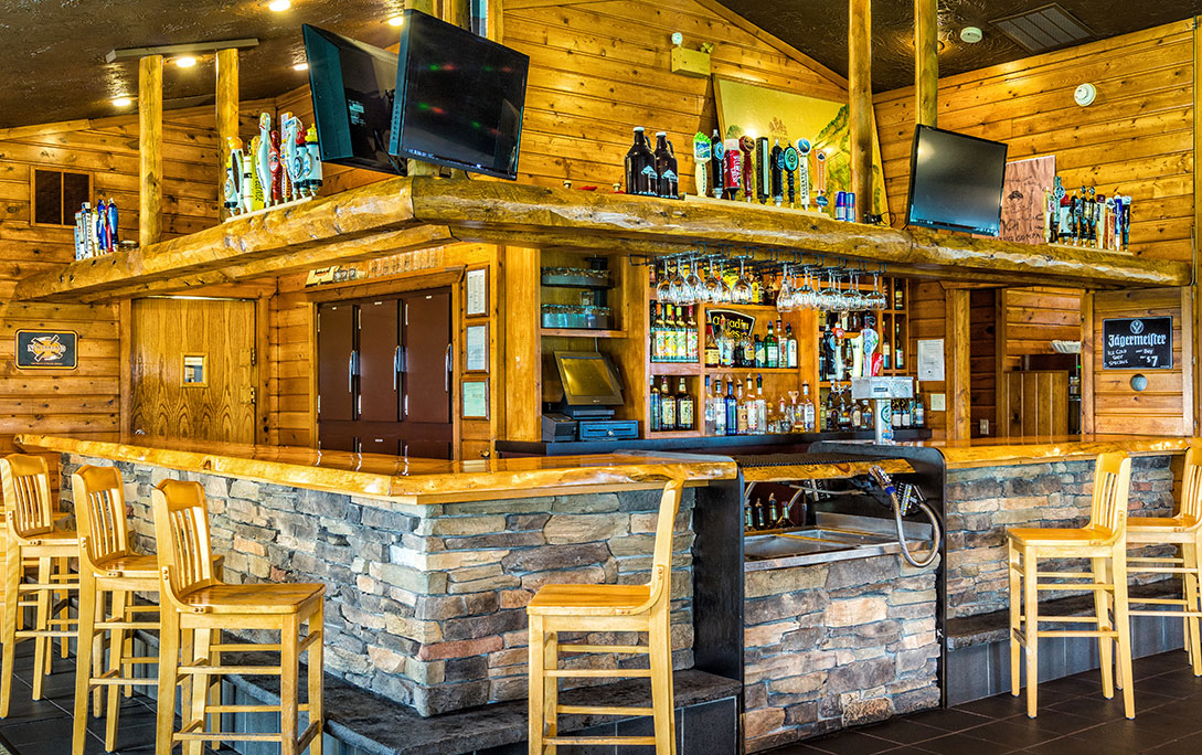 the bar at Legends on the Hill with fully stocked bar and flat screen TVs