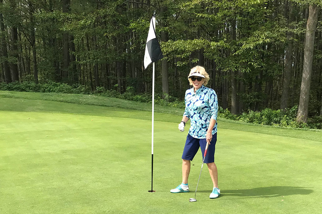 Female golfer in green