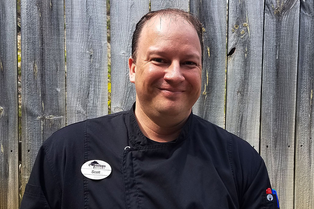 Head shot of Scott Rutter in a chef coat