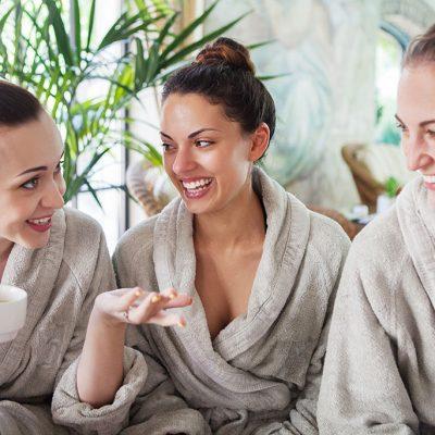 3 girls in tan robes laughing
