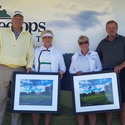 2 couples in golf attire accepting awards