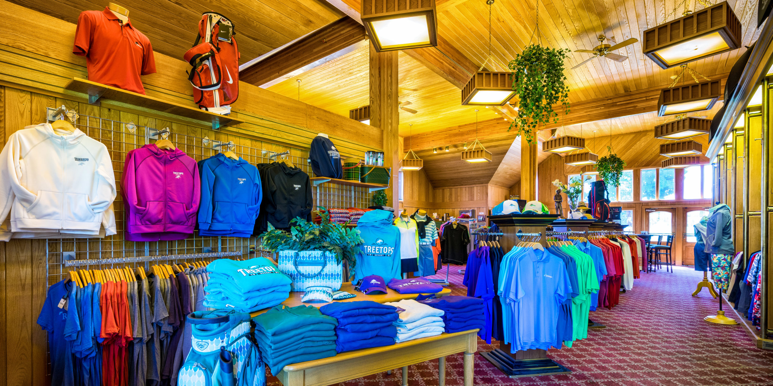 Polo shirts, sweatshirts, golf bags, and more on display at the Jones Pro Shop at Treetops Resort.