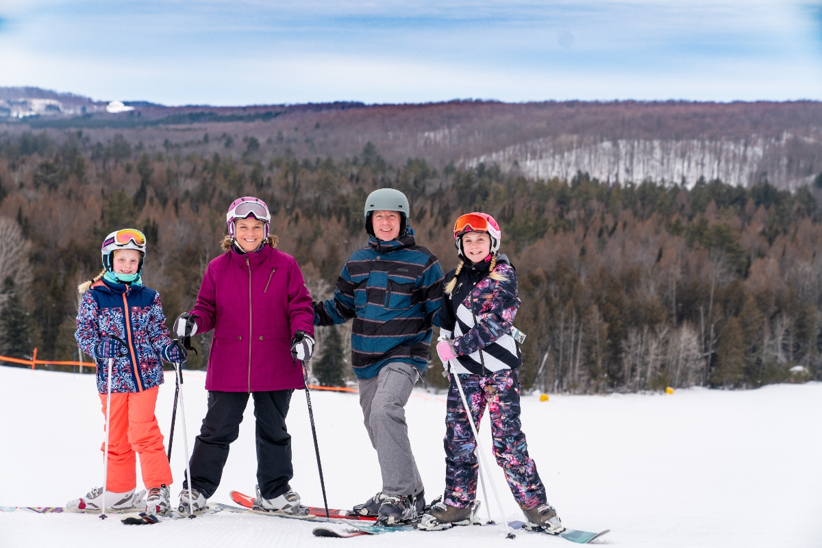 Winter family at top of the hill
