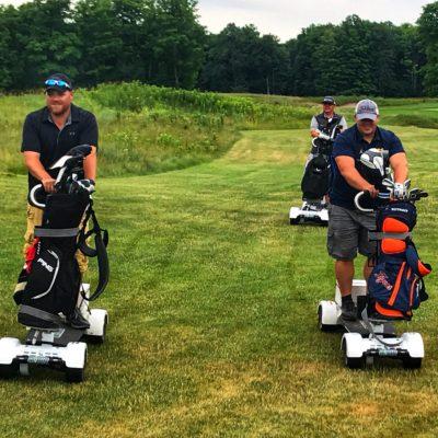 3 male golfers on golf boards